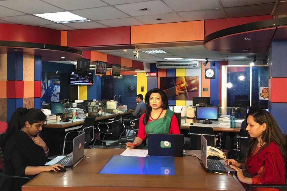 Bangladesh's first transgender news anchor Tashnuva Anan Shishir, center, reads news bulletin , in Dhaka, Bangladesh, Tuesday, March 9, 2021.