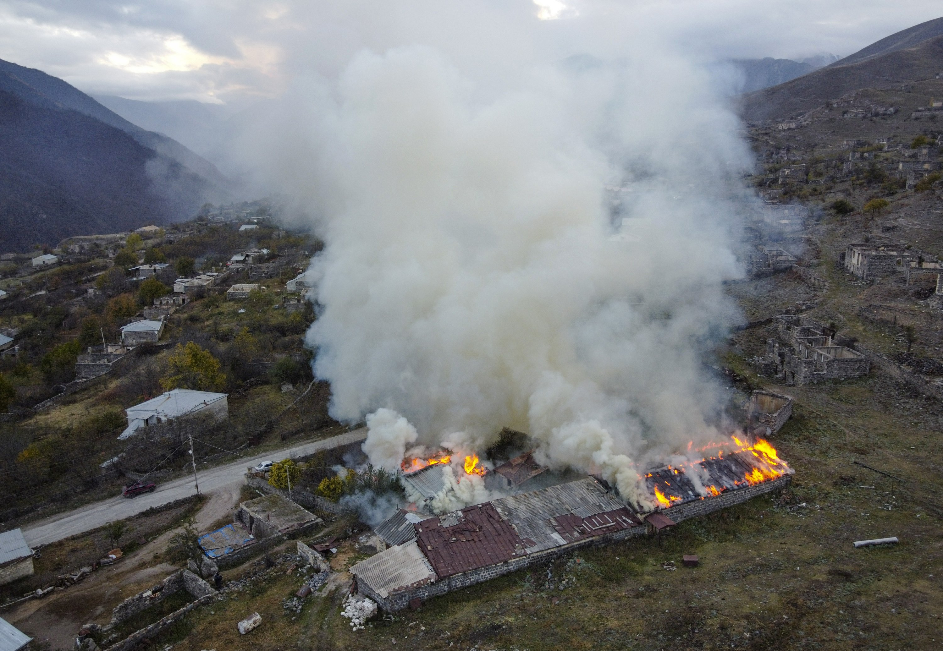 Armenians torch their homes on land ceded to Azerbaijan