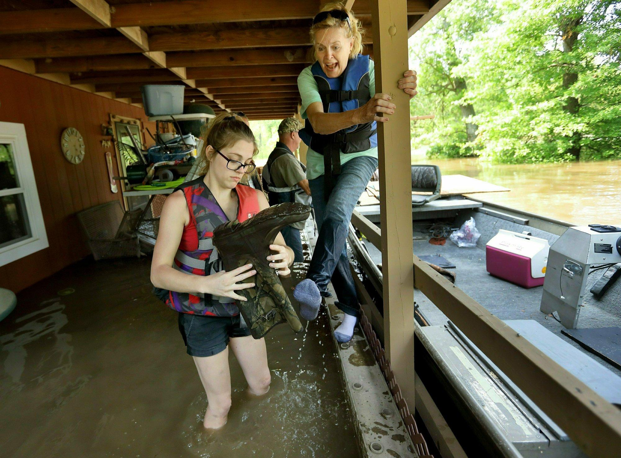 The Latest: Mike Pence to visit flood-damaged Oklahoma