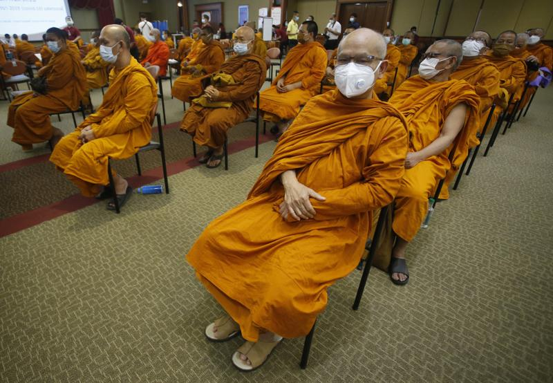 Buddhist monks wait to receive Sinovac COVID-19 vaccines at Priest hospital in Bangkok, Thailand Tuesday, May 18 , 2021. Thailand had about 7,100 cases, including 63 deaths, in all of last year, in what was regarded as a success story. Taxi drivers are starved for customers, weddings are suddenly canceled, schools are closed, and restaurant service is restricted across much of Asia as the coronavirus makes a resurgence in countries where it had seemed to be well under control. (AP Photo/Anuthep Cheysakron)