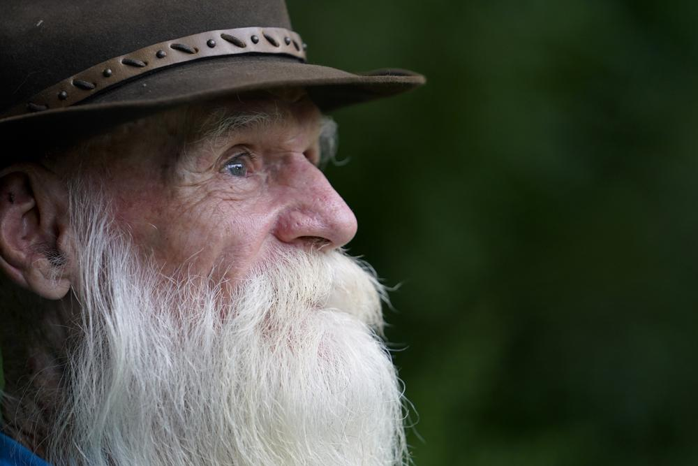 """David Lidstone, 81, speaks with reporters during an interview Tuesday, Aug. 10, 2021, in Boscawen, N.H. Lidstone, an off-the-grid New Hampshire hermit known to locals as """"River Dave,"""" had been living in a cabin in the woods along the Merrimack River, in Canterbury, N.H., for nearly three decades. He was jailed July 15, 2021 on a civil contempt sanction and was told he'd be released if he agreed to leave the cabin, that has since burnt down. (AP Photo/Steven Senne)"""
