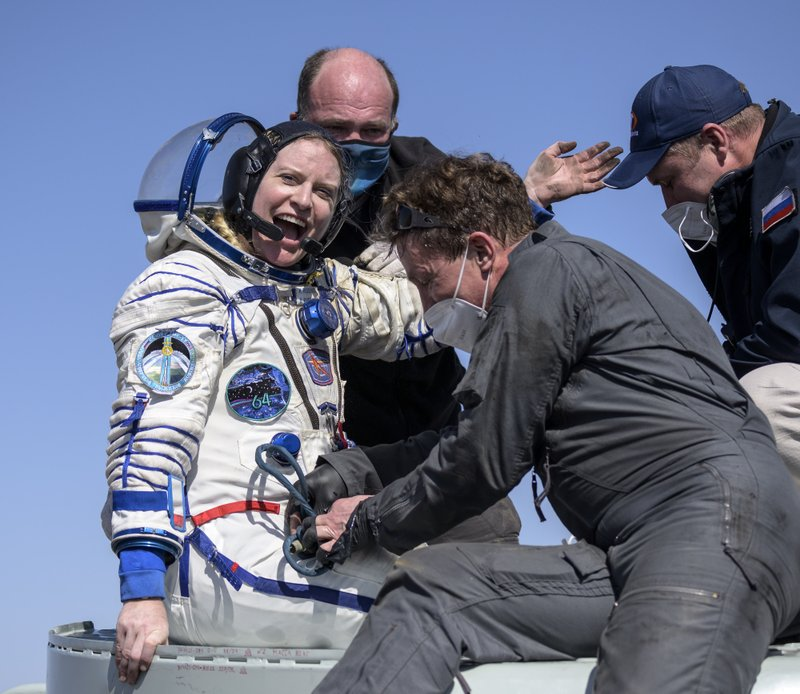 An American and two Russians return to earth after six months aboard the International Space Station