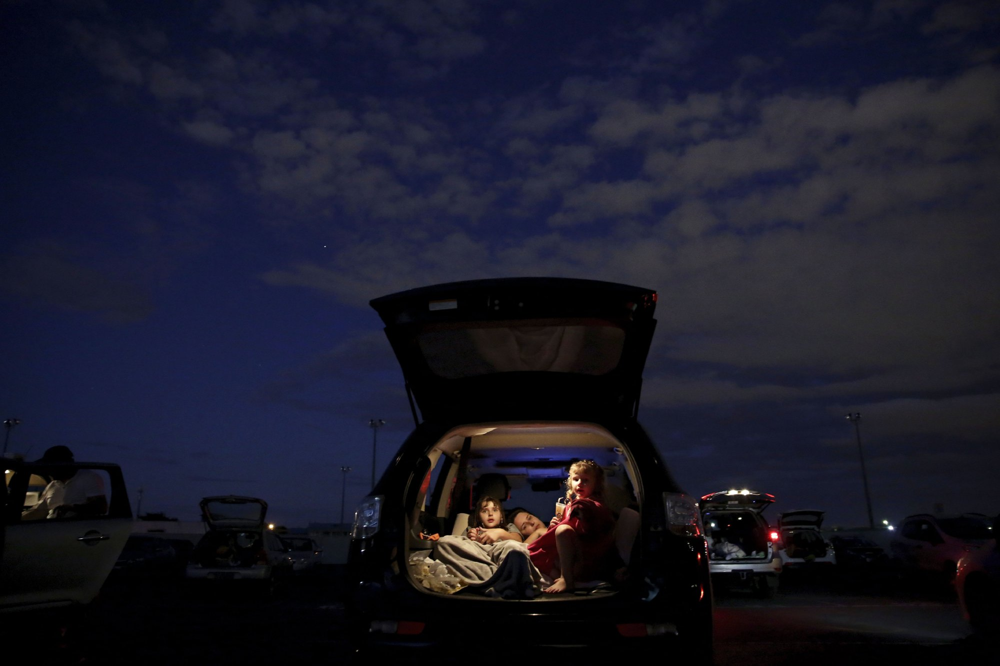 Brazilians escape the horrors of the virus by spending a few hours at the drive-in