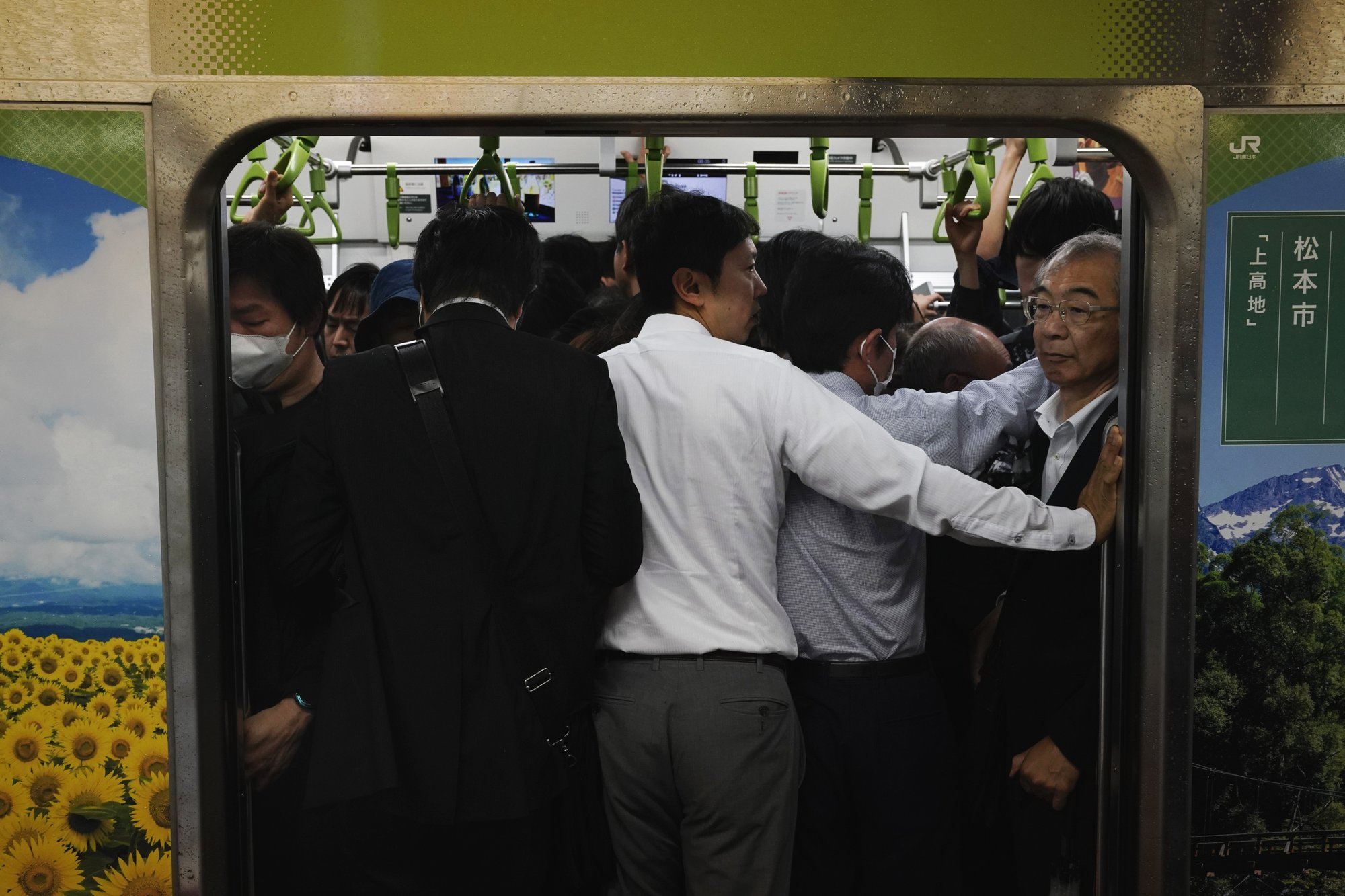 AP Photos: In the loop: Tokyo seen from commuter train line