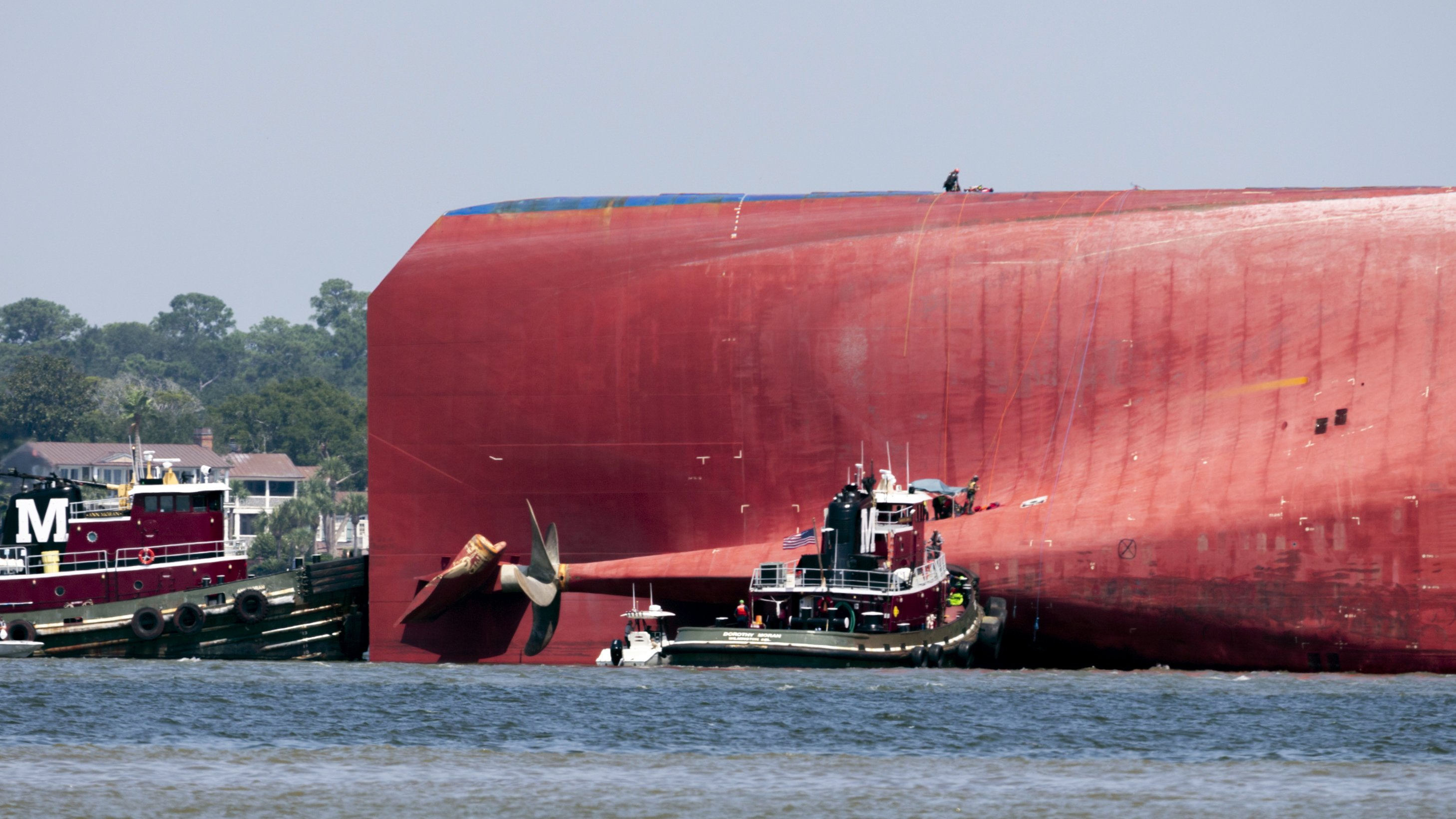 Fourth and final crewman pulled alive from capsized ship