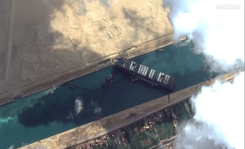 Wedged ship still stuck in Suez Canal; removal date not known; global trade disrupted