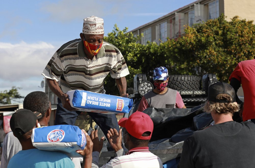 There's some good in all of us: Working side-by-side, notorious gang members deliver bread, flour, and vegetables to poor struggling families  during South Africa's coronavirus lockdown,
