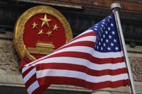 FILE - In this Nov. 9, 2017, file photo, an American flag is flown next to the Chinese national emblem during a welcome ceremony for visiting U.S. U.S. officials are issuing new warnings about China's ambitions in artificial intelligence and a range of advanced technologies that could eventually give Beijing a decisive military edge and possible dominance over health care and other essential sectors in America. (AP Photo/Andy Wong, File)