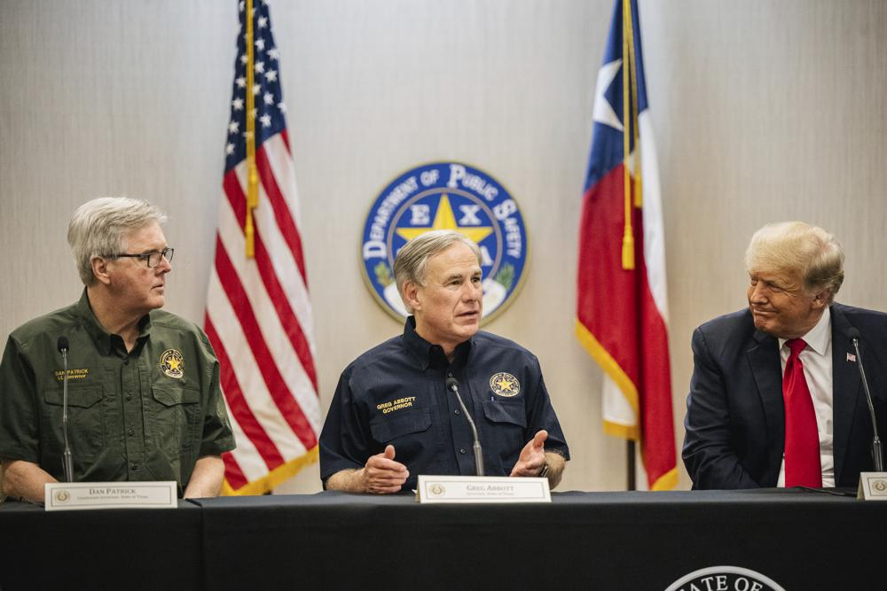 Texas Lt. Gov. Dan Patrick, left, Texas Gov. Greg Abbott, center, and former President Donald Trump attend a border security briefing to discuss further plans in securing the southern border wall on Wednesday, June 30, 2021, in Weslaco, Texas. (Brandon Bell/Pool via AP)