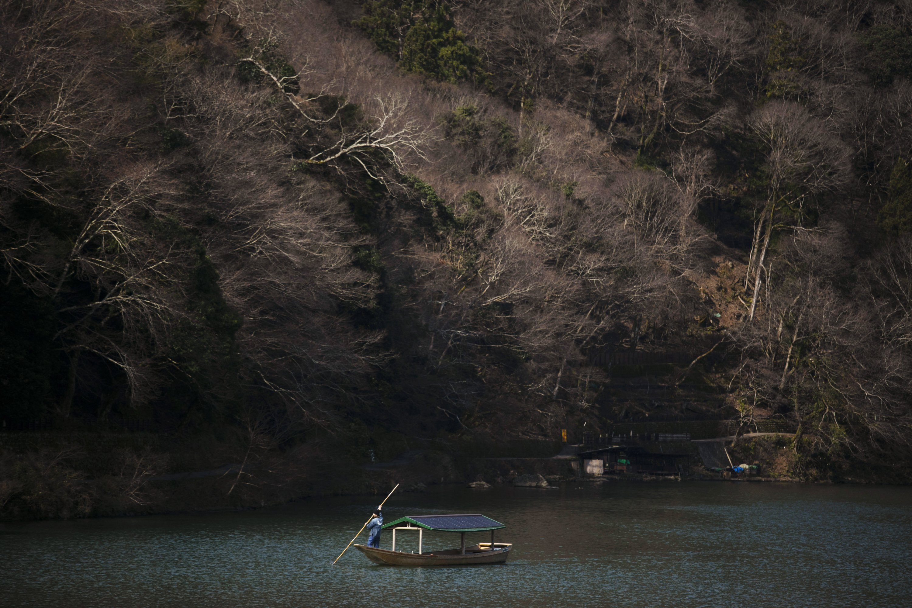 AP PHOTOS: Cherry blossoms, empty stores in virus-hit Japan