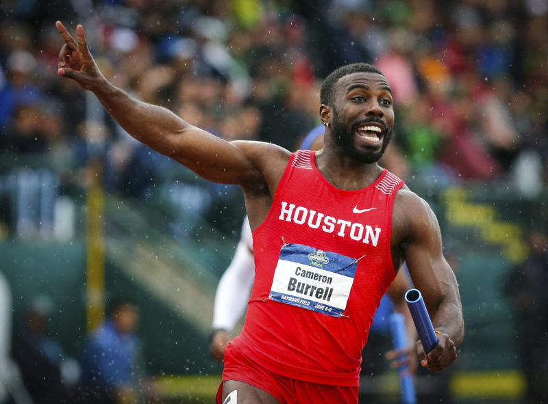 FILE - In this June 8, 2018 file photo, Houston's Cameron Burrell raises two fingers to indicate Houston's back-to-back men's 400-meter relay wins, during the third day of the NCAA Outdoor Track and Field Championships at Hayward Field in Eugene, Ore. Burrell, the former NCAA national champion sprinter died on Monday, Aug. 9, 2021 according to the University of Houston, where he starred from 2013-2018. (Andy Nelson/The Register-Guard via AP, File)