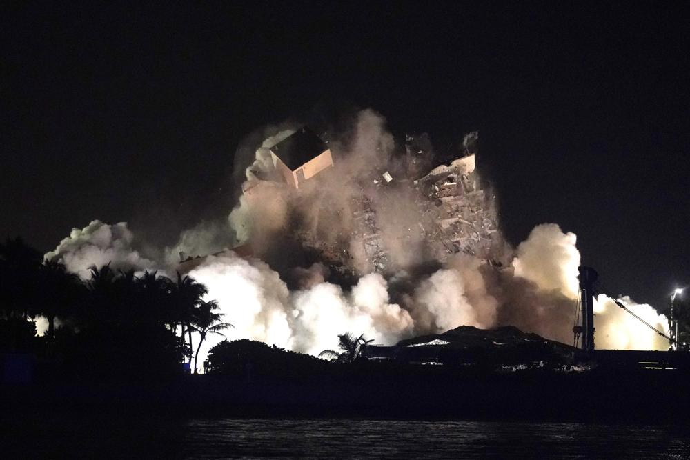 The remaining structure of the Champlain Towers South condo building is demolished more than a week after it partially collapsed, late Sunday, July 4, 2021, in Surfside, Fla. (AP Photo/Lynne Sladky)
