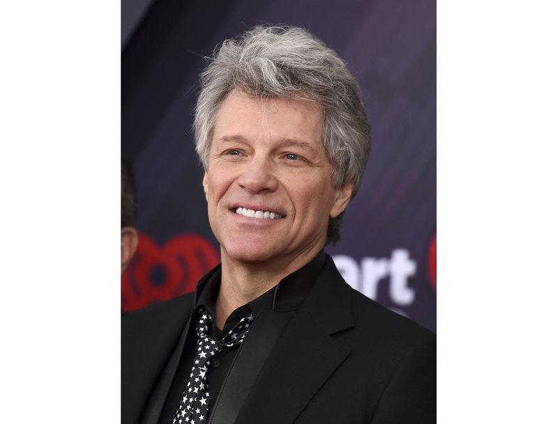 Singer Jon Bon Jovi encourages  kindergartners to help wherever they can