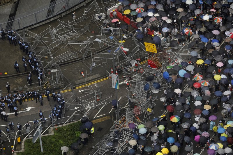 Protesters gather outside the Legislative Council in Hong Kong, June 12, 2019. (AP Photo/Vincent Yu)