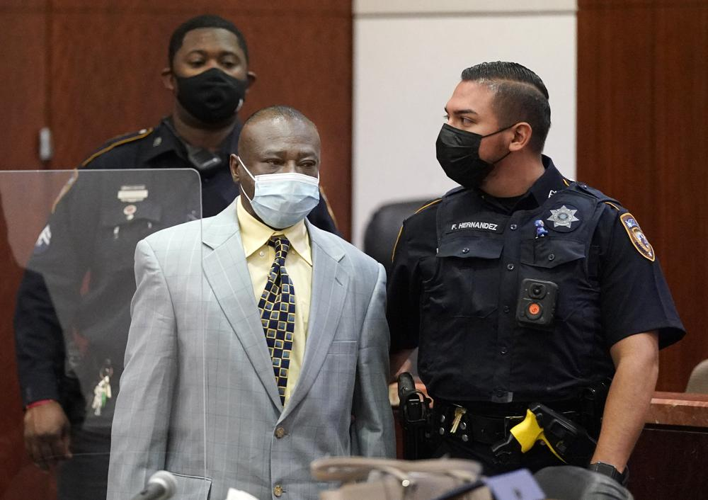 David Conley is escorted into the Harris County Criminal Court of Judge Chuck Silverman during his trial Tuesday, Oct. 5, 2021 in Houston, for the murders of eight people. Prosecutors are not seeking the death penalty, saying he has a mental disability. (Melissa Phillip/Houston Chronicle via AP)