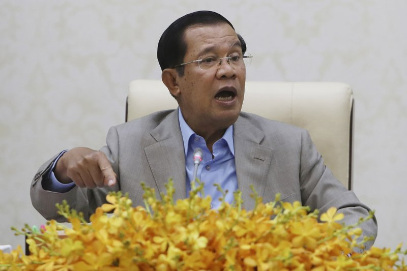 "Cambodia opens mass ""sham"" trial of nearly 130 opponents and government critics"