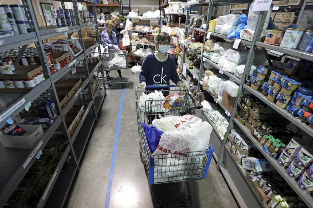 """""""About 50% of the people coming through our lines have never been here before,"""" said GraceWorks President and CEO Valencia A. Breckenridge as the coronavirus plague sends people to food pantries"""