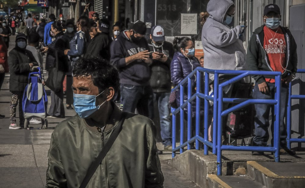 AP-NORC poll: Pandemic especially tough on people of color