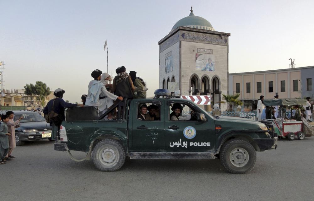 Taliban fighters patrol inside the city of Kandahar, southwest Afghanistan, Sunday, Aug.  15, 2021. (AP Photo/Sidiqullah Khan)