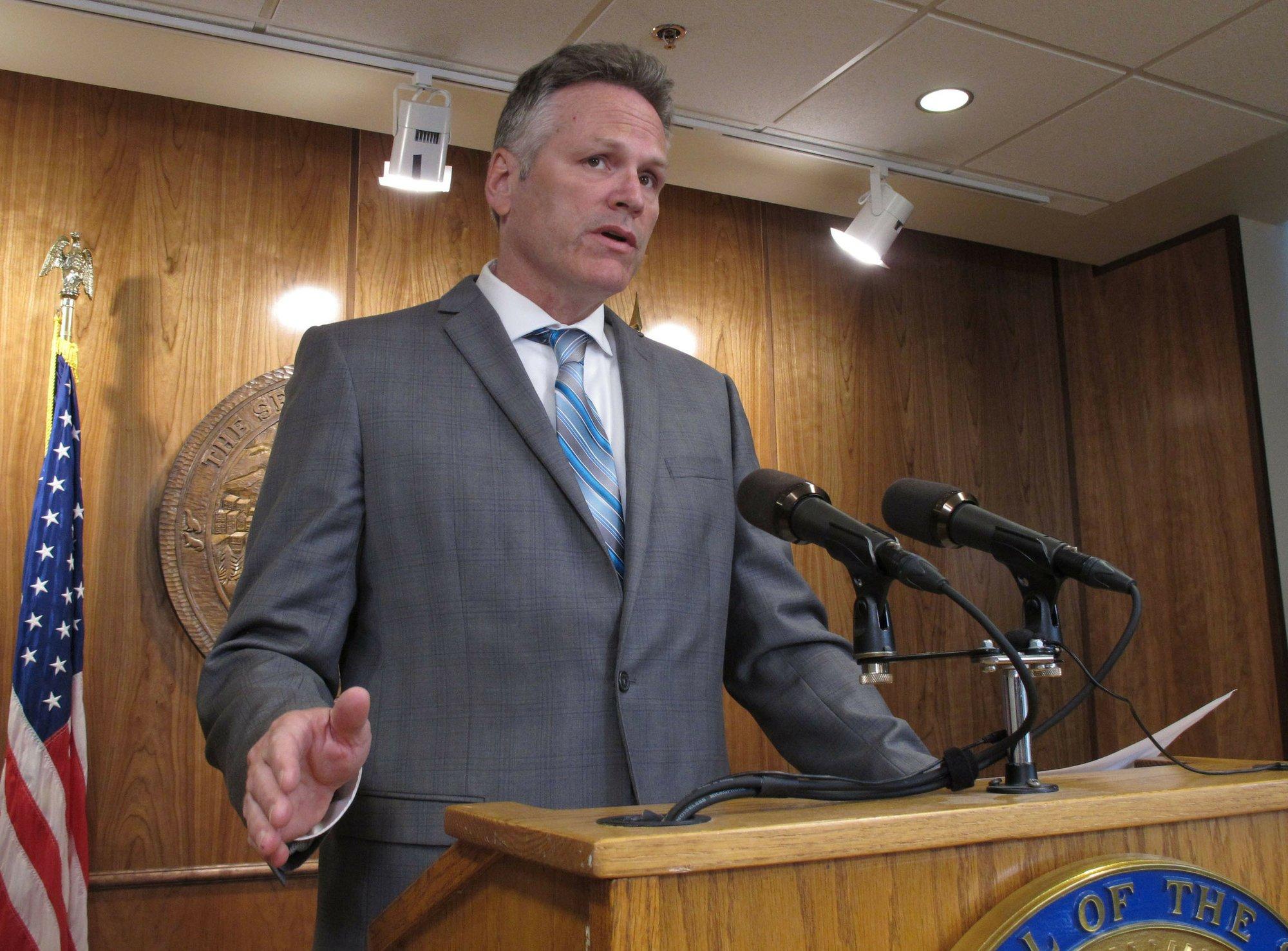 Alaska governor OKs smaller oil-wealth check for now