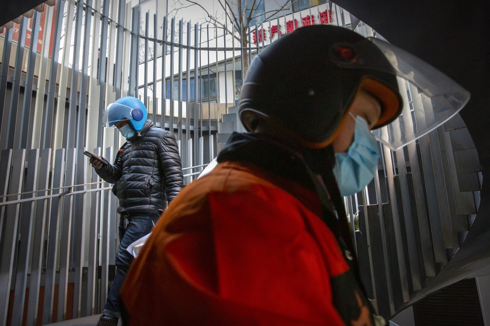 Asia update: Virus restrictions heightened in China province