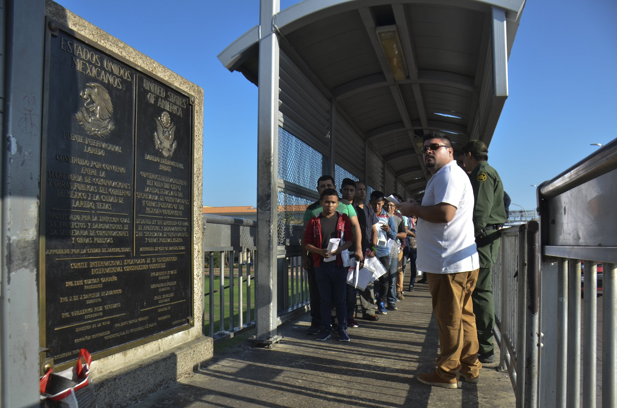 Tent courtrooms open to process migrants waiting in Mexico
