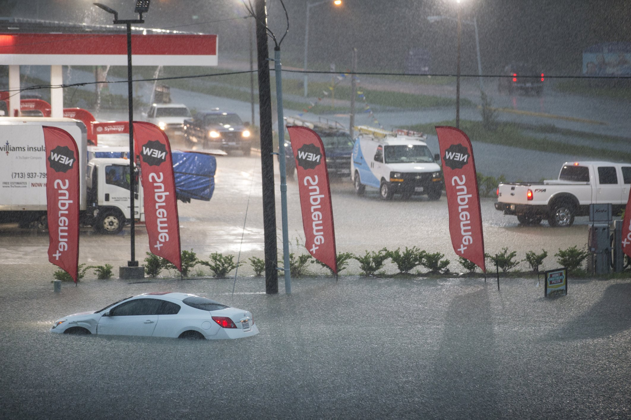 The Latest: More than 1,000 rescues, evacuations in floods