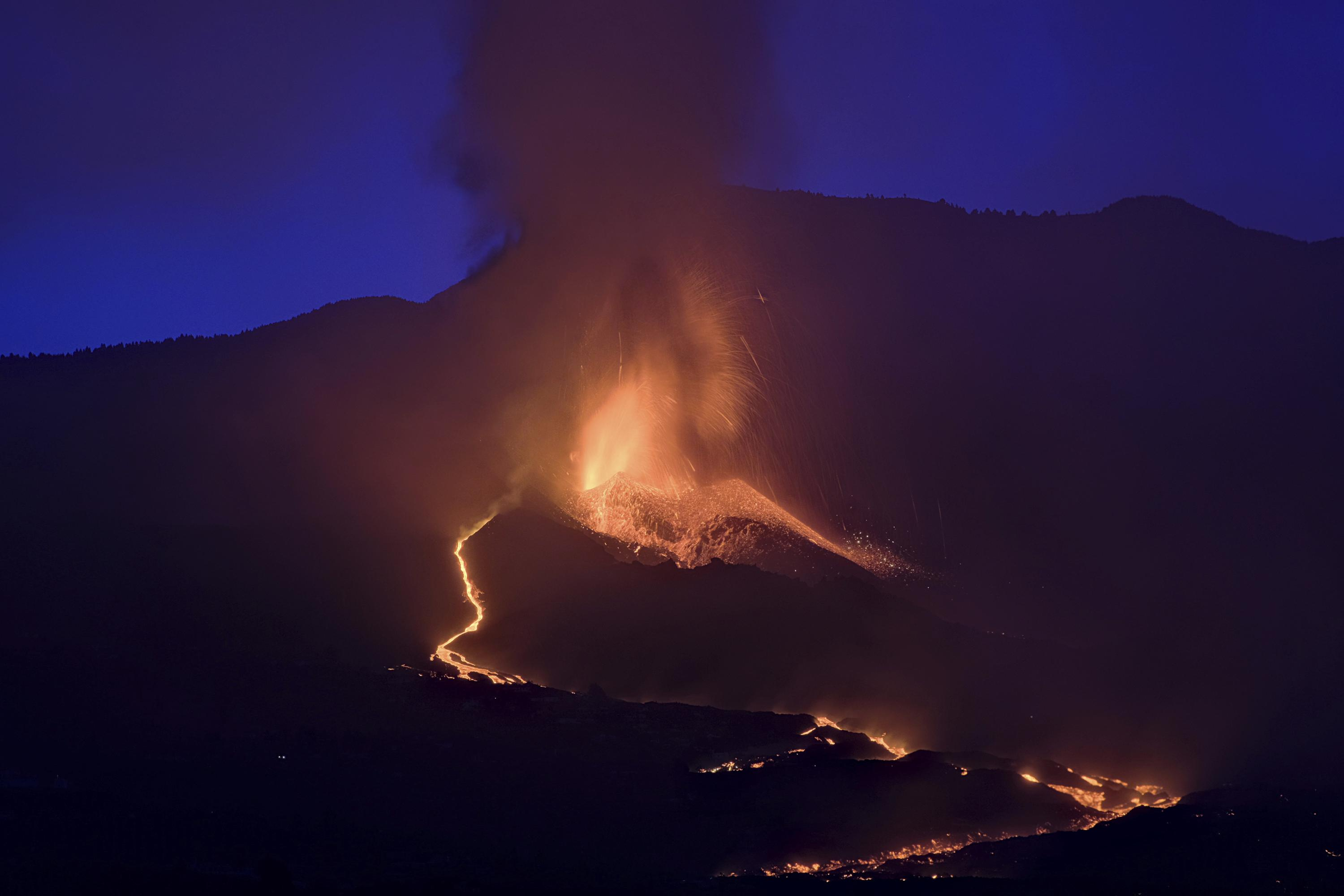 Airport reopens on Spanish island roiled by volcano eruption