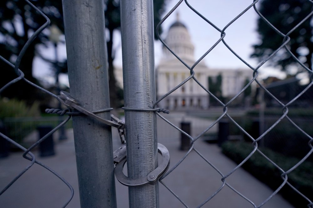 FBI warnings of potential for violence at state capitols have them boarded up, fenced off, patrolled by troops