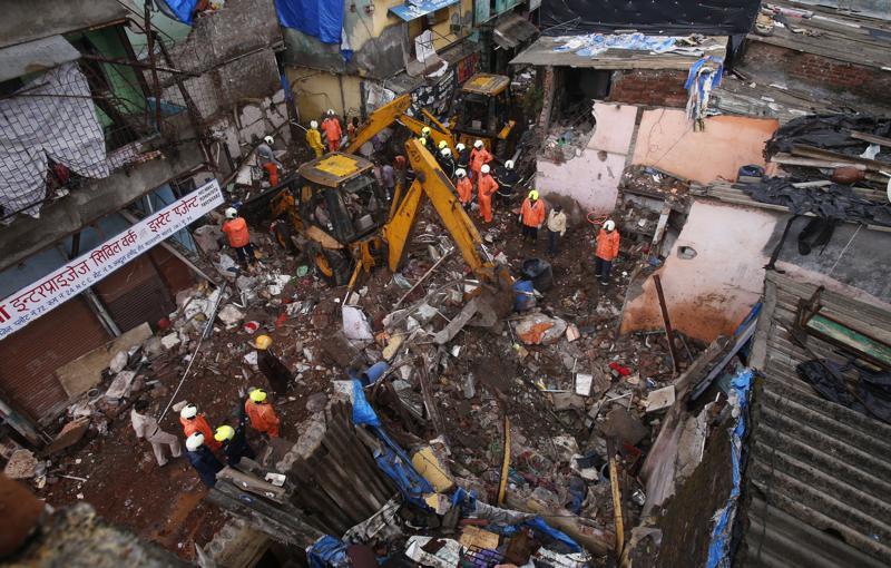 NEW DELHI,Mumbai,Building collapse kills 11 after monsoon flooding in Mumbai ,harbouchanews