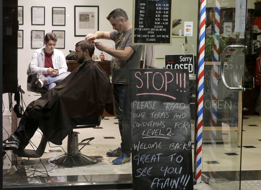 New Zealand barber has about 50 calls for midnight haircut as nation drops most of its lockdown restrictions