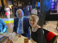 This photo shows Don and Margie Varnadoe attending a March 2021 awards banquet in Savannah, Ga., for the real estate office where Don Varnadoe worked. The husband and wife from St. Simons Island, Ga.,were among three people killed when an Amtrak train derailed in Montana on Saturday, Sept. 25, 2021.   (Photo courtesy of Robert Kozlowski via AP)