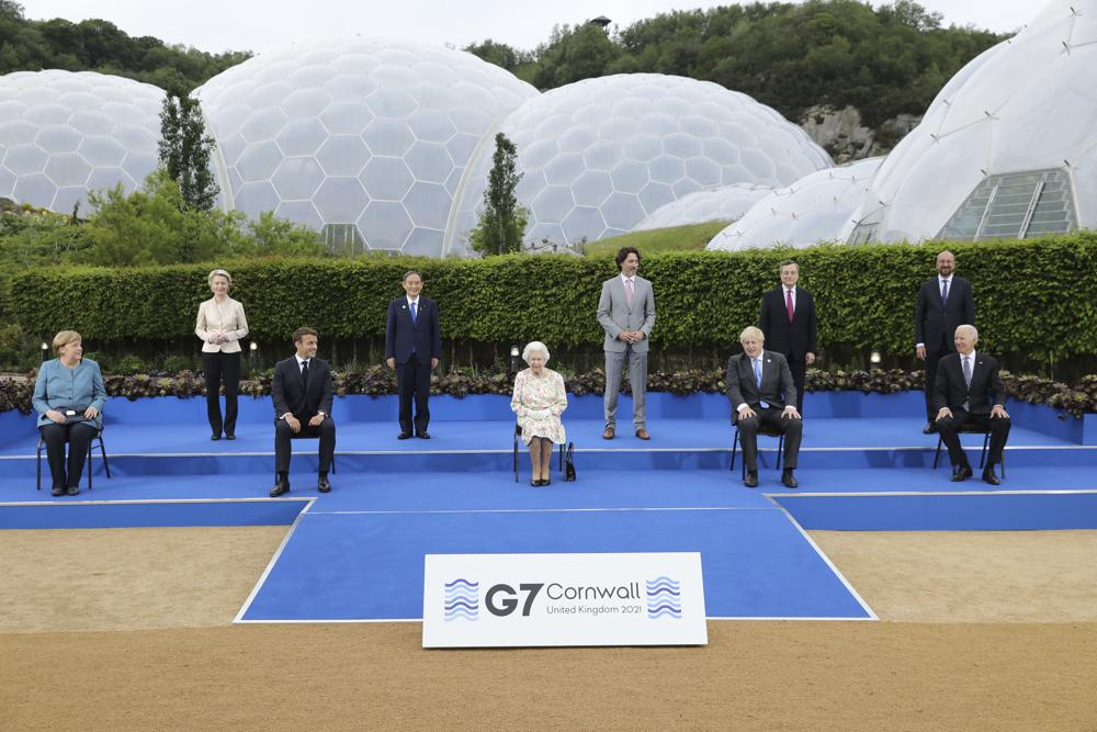 Britain's Queen Elizabeth II poses for a group photo with G7 leaders, from left, back row, President of the European Commission Ursula von der Leyen, Japan's Prime Minister Yoshihide Suga, Canada's Prime Minister Justin Trudeau, Italy's Prime Minister Mario Draghi and President of the European Council Charles Michel, from left, front row, German Chancellor Angela Merkel, French President Emmanuel Macron, Britain's Prime Minister Boris Johnson and US President Joe Biden before a reception at the Eden Project in Cornwall, England, Friday June 11, 2021, during the G7 summit. (Jack Hill/Pool via AP)