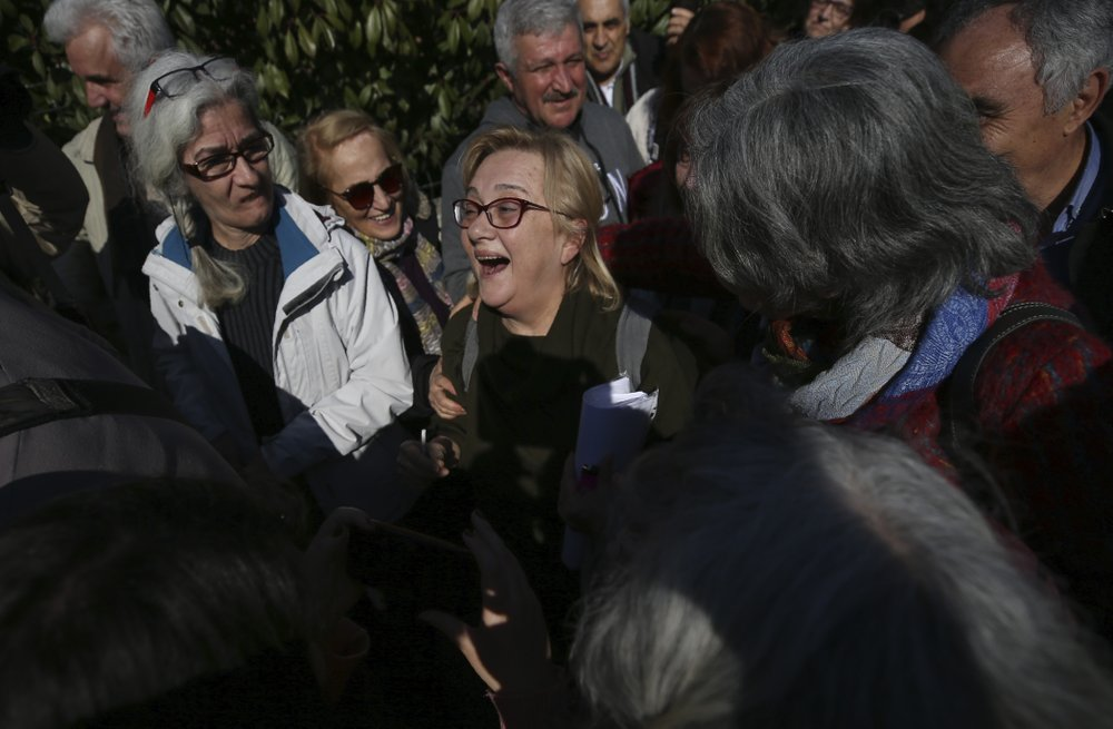 Turkish philanthropist kept jailed hours after acquittal