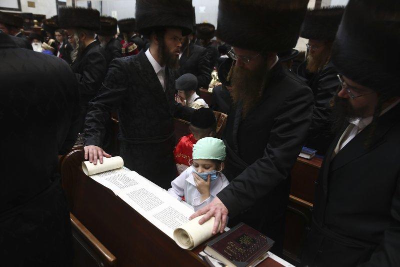 Virus outbreak upsets Jewish holidays celebration of Purim