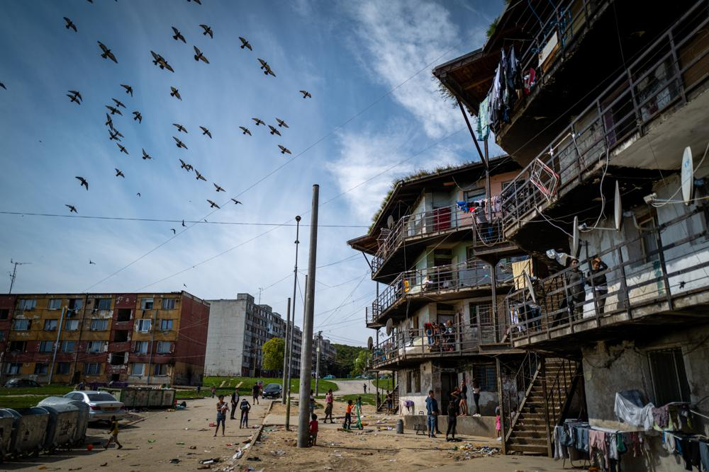 """Birds fly above the Roma settlement at the Lunik IX quarter of Slovakia's second largest city of Kosice, Sunday, Sept. 5, 2021. Pope Francis will make his visit to the impoverished Roma community in Slovakia one of the highlights of his pilgrimage to """"the heart of Europe."""" Francis will be the first pontiff to meet the most socially excluded minority group in that Central European country. (AP Photo/Peter Lazar)"""