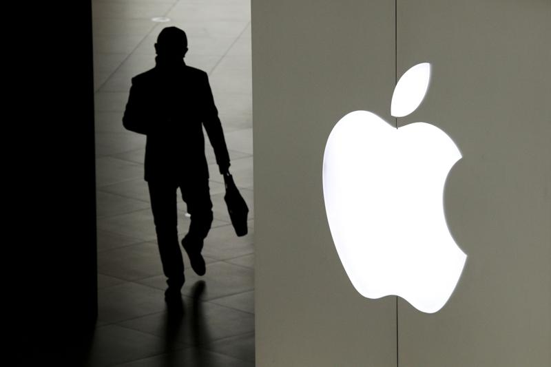 FILE – In this Jan. 3, 2019, file photo, a man leaves an Apple store in Beijing. Two years ago, Apple threatened to pull Facebook and Instagram from its app store over concerns about the platform being used as a tool to trade and sell maids in the Mideast. (AP Photo/Andy Wong, File)