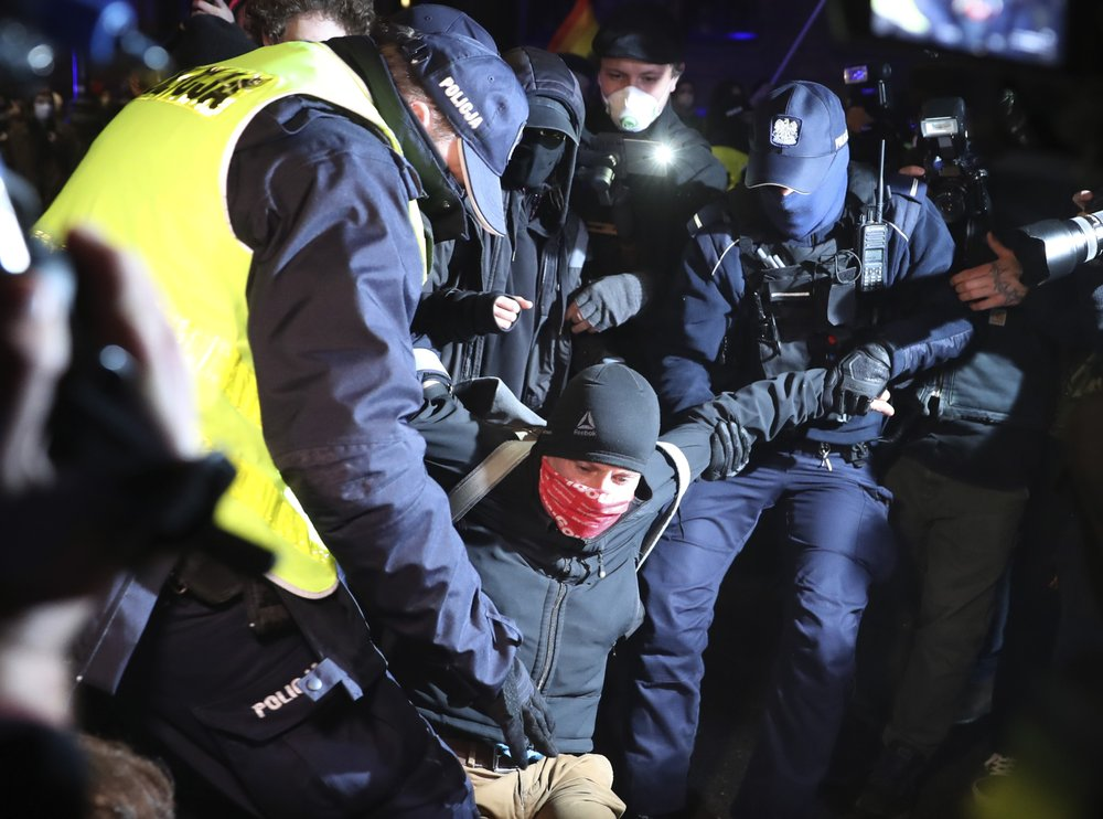 Polish police carry away abortion rights protesters blocking street in nation's capital