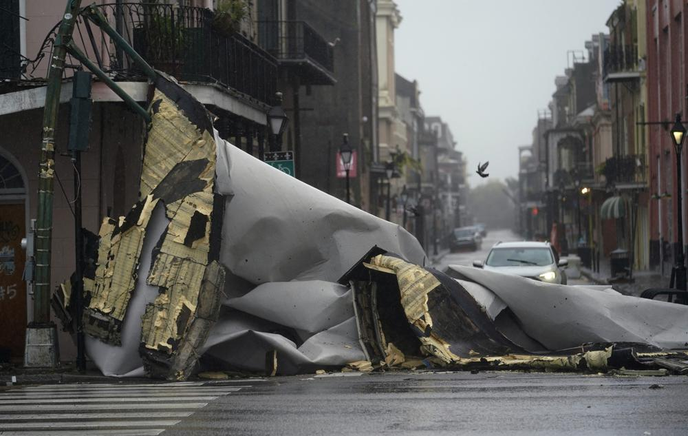 A section of roof that was blown off of a building in the French Quarter by Hurricane Ida winds blocks an intersection, Sunday, Aug. 29, 2021, in New Orleans. (AP Photo/Eric Gay)