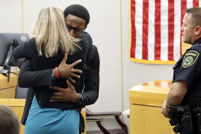 Slain man's brother, judge hug ex-cop sentenced to 10 years