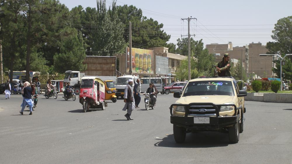 Members of the Taliban drive through the city of Herat, Afghanistan, west of Kabul, on Saturday, Aug.  14.2021, after taking the province from the Afghan government.  (AP Photo/Hamed Sarfarazi