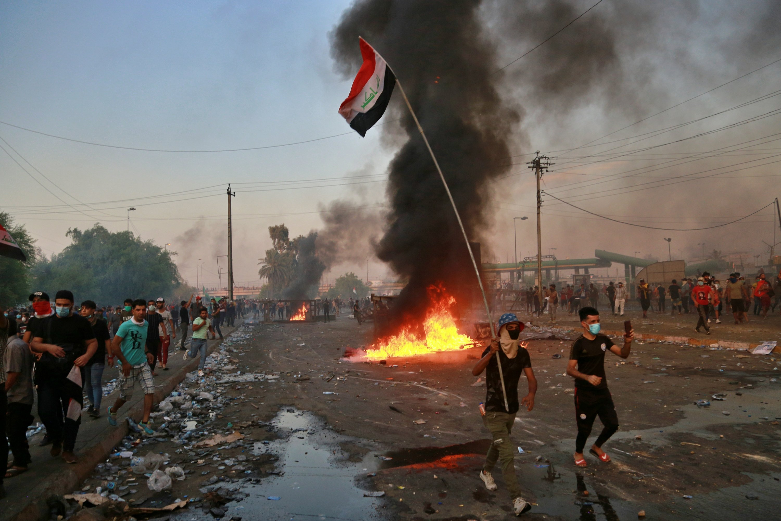 The Latest: Iraqi officials say 10 more protesters killed