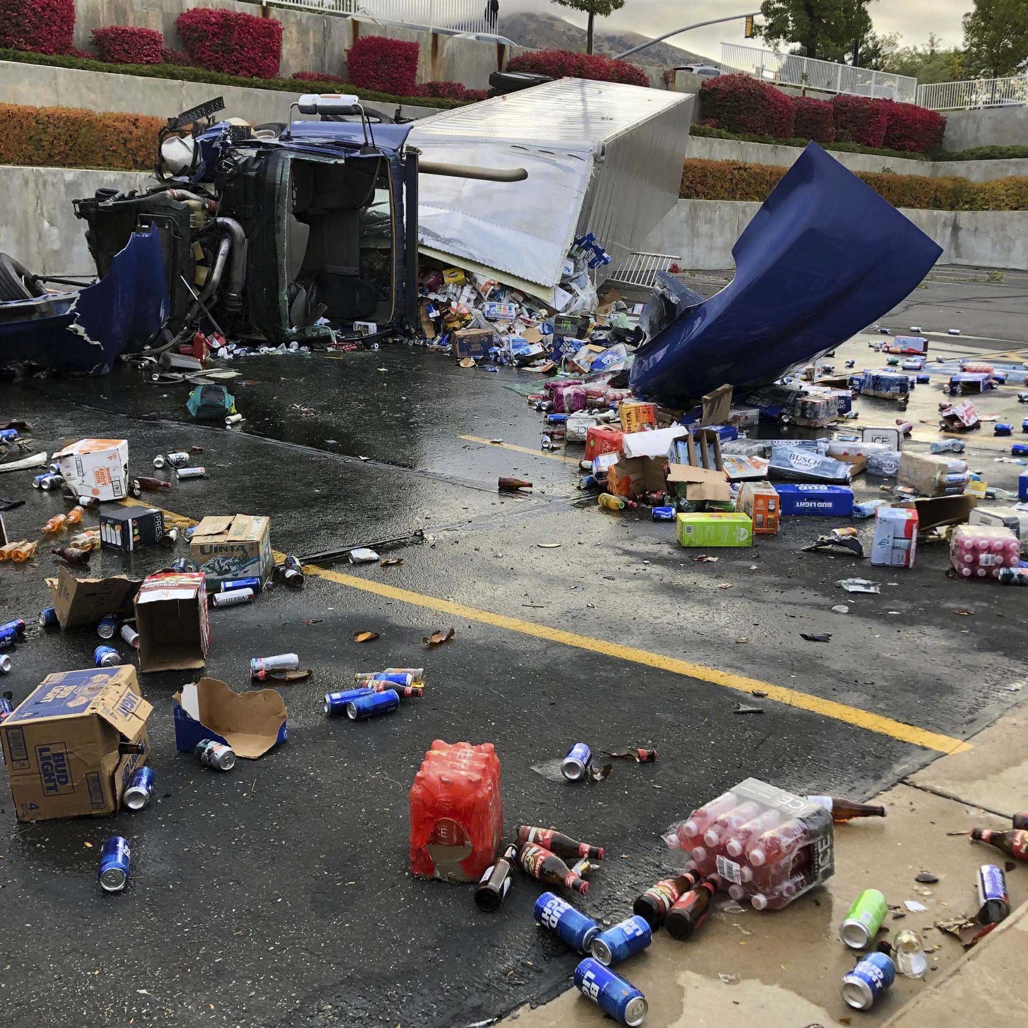 Beer all over Mormon church parking lot after truck crashes