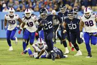 Tennessee Titans running back Derrick Henry (22) runs 76 yards for a touchdown against the Buffalo Bills in the first half of an NFL football game Monday, Oct. 18, 2021, in Nashville, Tenn. (AP Photo/Mark Zaleski)