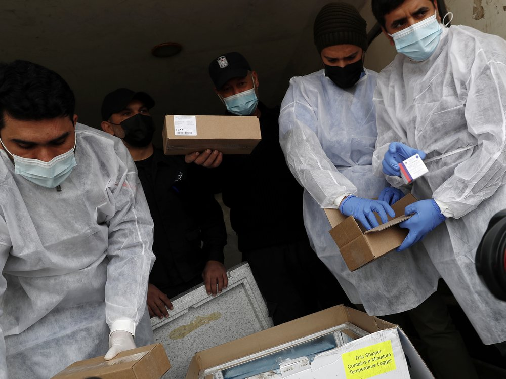 First shipment of coronavirus vaccines to arrive into Hamas-run Gaza Strip