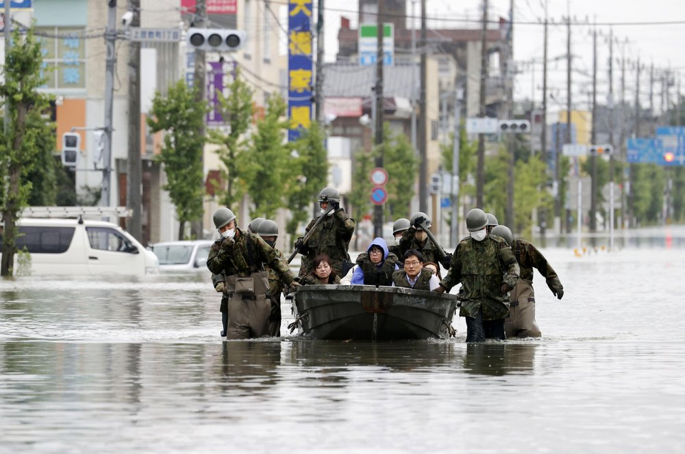 Flooding in Japan leaves up to 55 dead and dozens missing