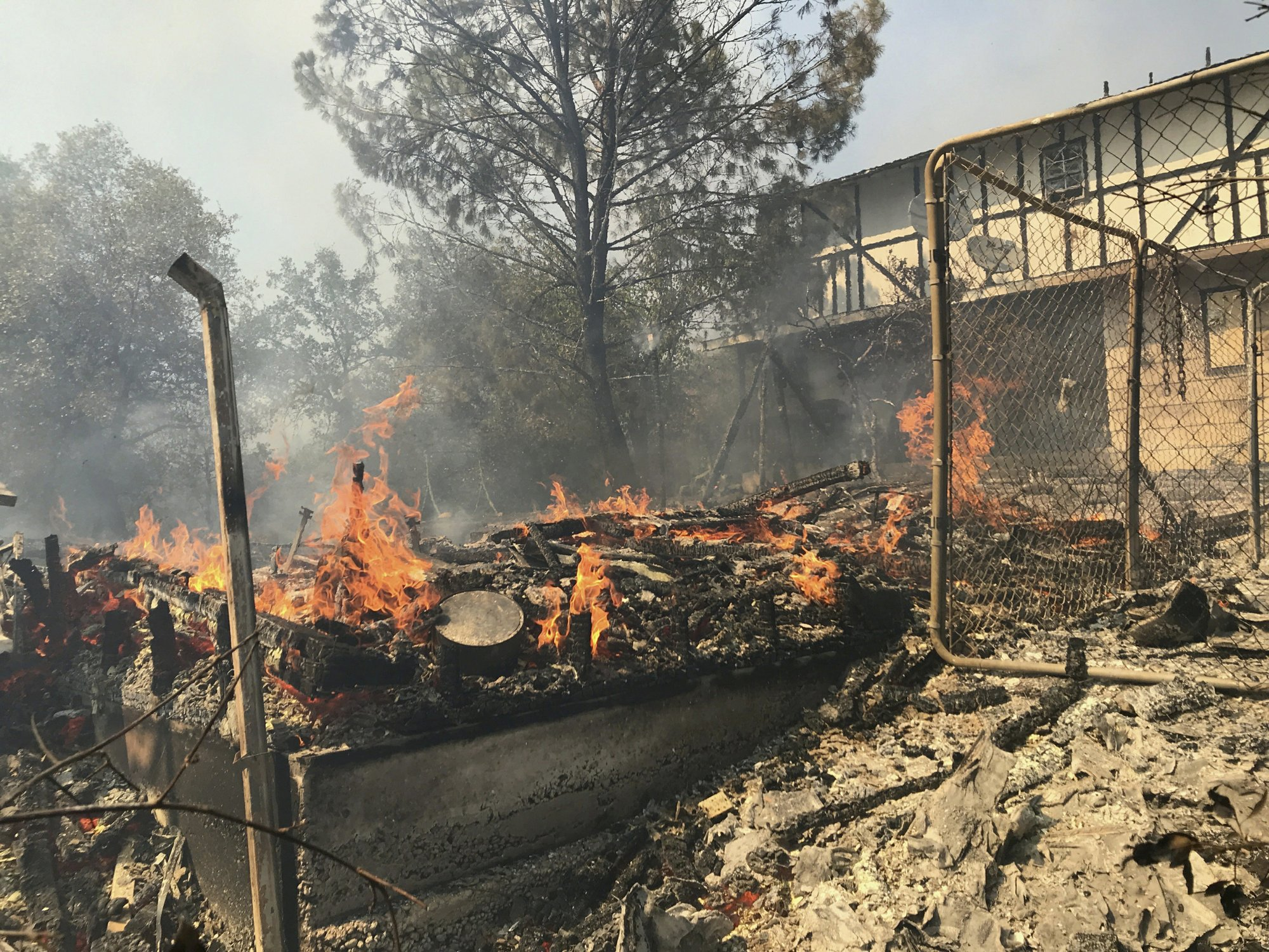 Containment increased on California wildfire, 3 homes lost