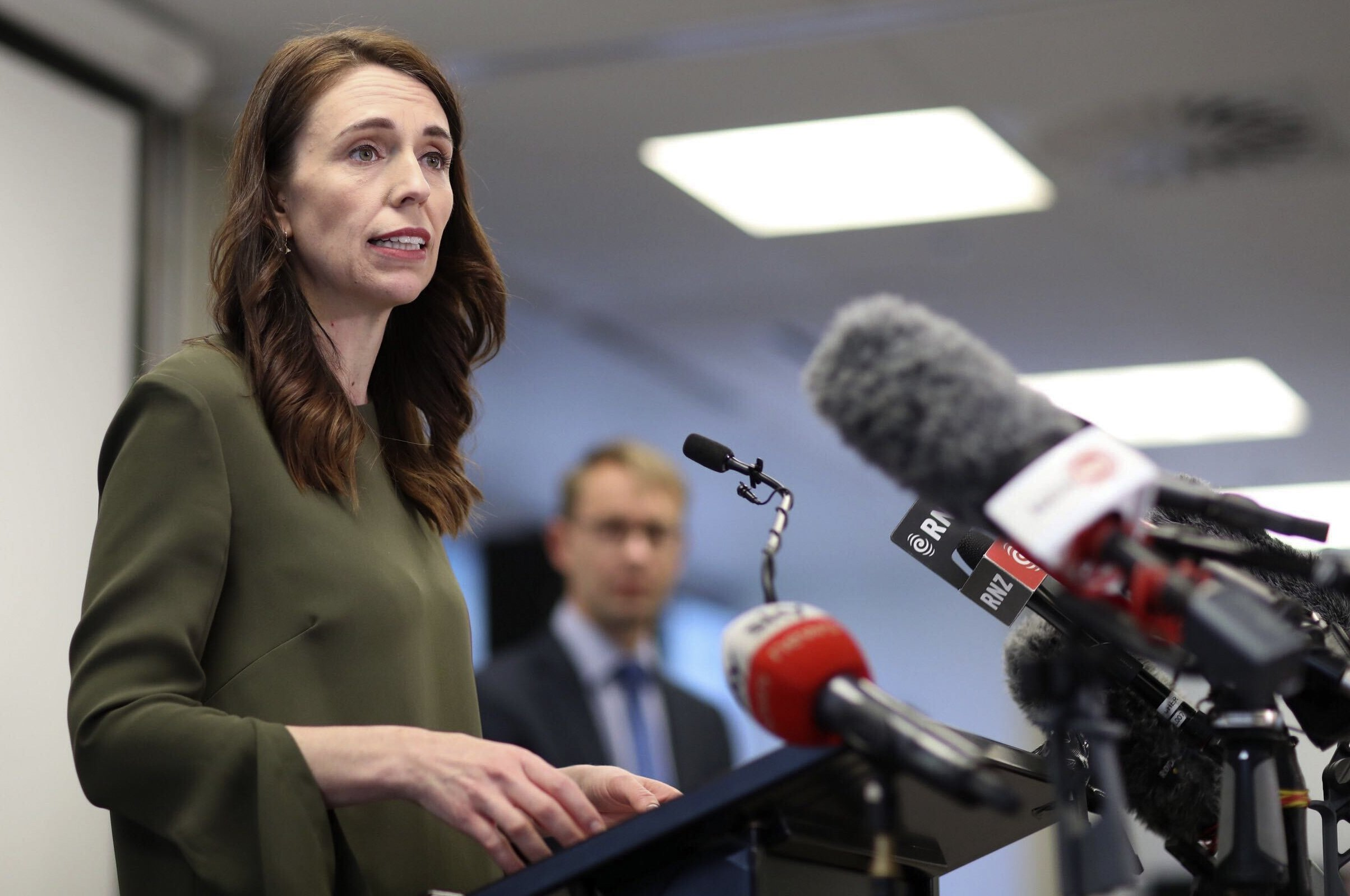 Asia Today: New Zealand to begin lifting virus restrictions