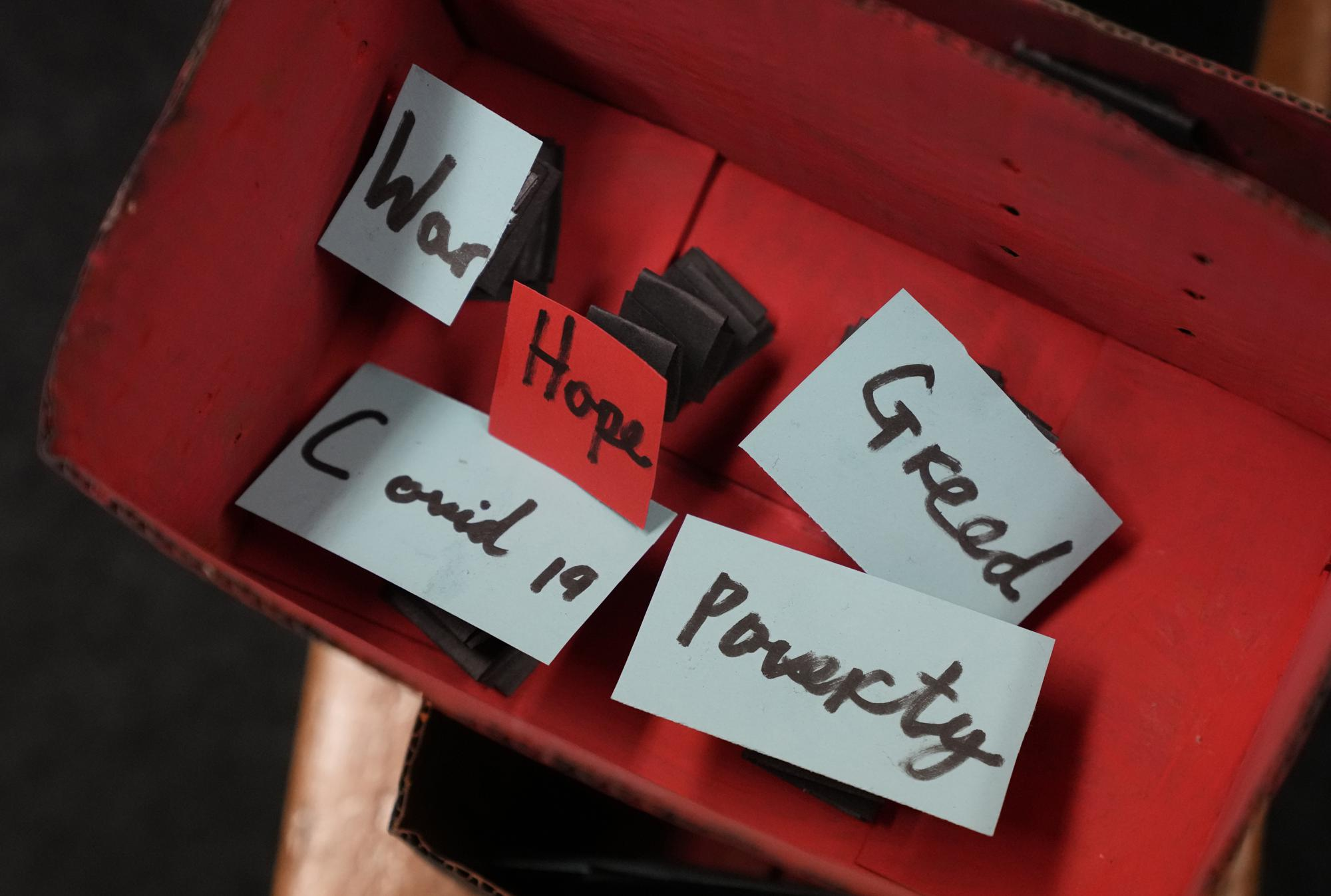 An unfinished 'Pandora's Box' things the pupils of year 3 feel are wrong along with the word 'Hope' is displayed in the classroom at the Holy Family Catholic Primary School in Greenwich, London, Wednesday, May 19, 2021. (AP Photo/Alastair Grant)