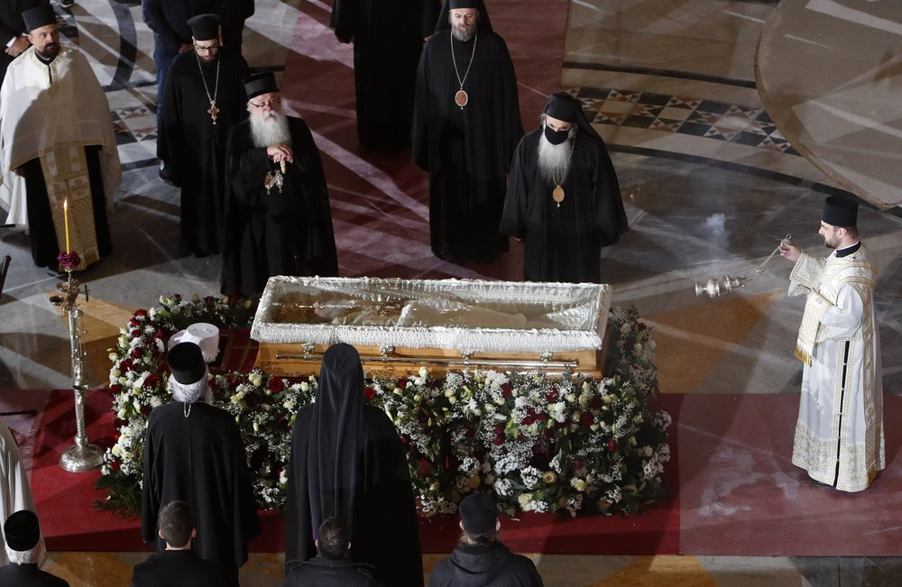 Ignoring social distancing, mourners pay respects to Serb Patriarch Irinej